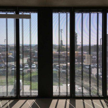 Lamellensystem zur Beschattung, drehbar, aus Lochblech, Fassade der Firma Marti GmbH
